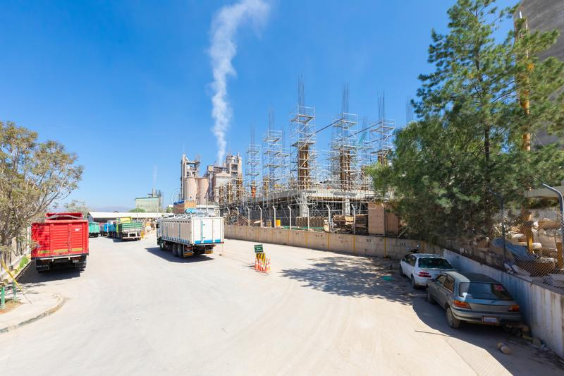 Sucre Bolivia national cement factory building under construction. Sucre Bolivia September 27 this is Bolivia`s national cement factory where extension work is stock photo