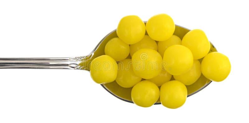 Sucrerie de citron dans une cuillère photo libre de droits
