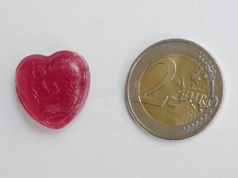 Sucrerie de coeur d'amour de pièce de monnaie de l'euro deux image stock