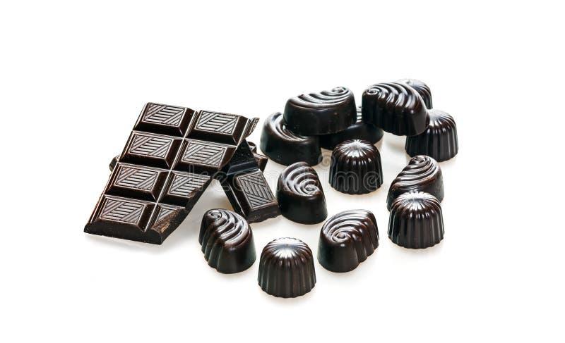 Sucrerie et gros morceaux cassés de barre de chocolat foncé image stock