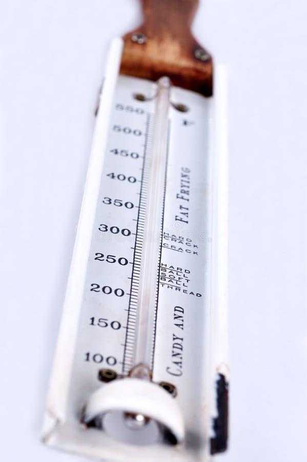 Sucrerie et gros thermomètre faisant frire images libres de droits
