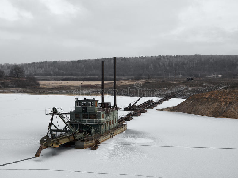 Suction dredge. In a winter lake royalty free stock photos