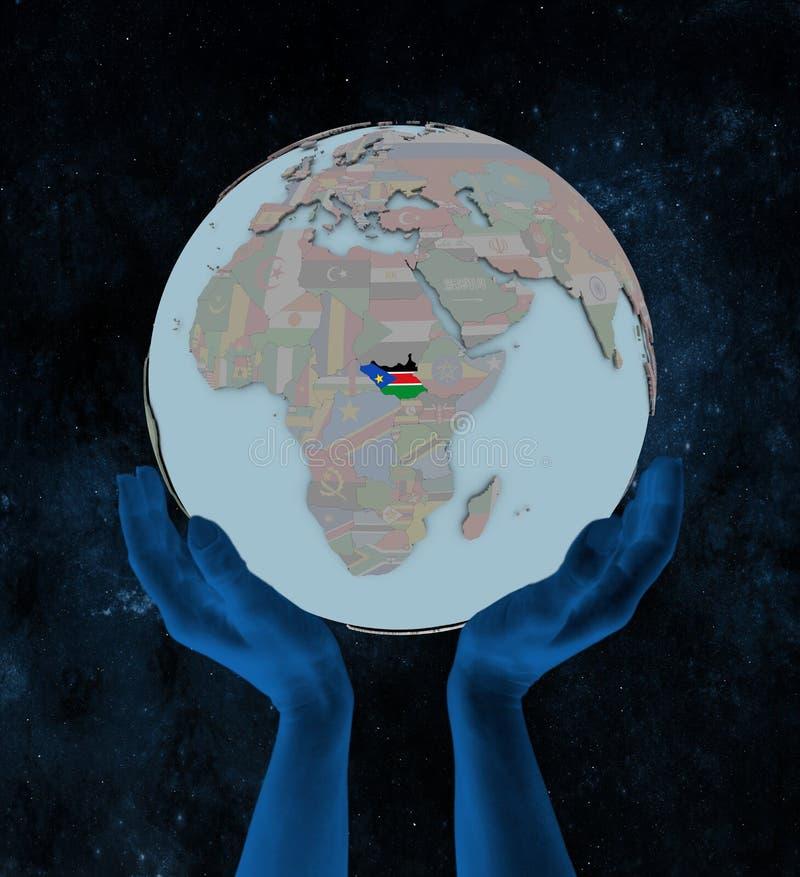 Sudán del sur en el globo político en manos stock de ilustración