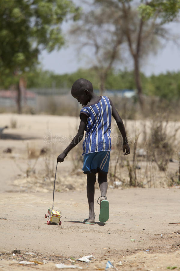 Sudanese boy with homemade toy stock image