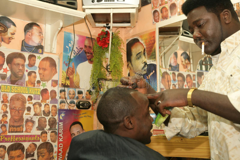 Download A Sudanese Refugee Working In A Barber Shop Editorial Photography - Image: 26234097