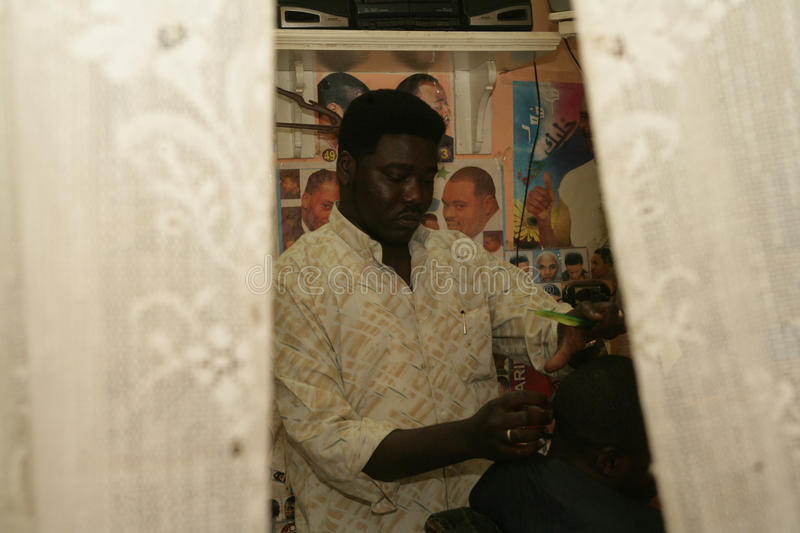 Download A Sudanese Refugee Working In A Barber Shop Editorial Image - Image: 26234110