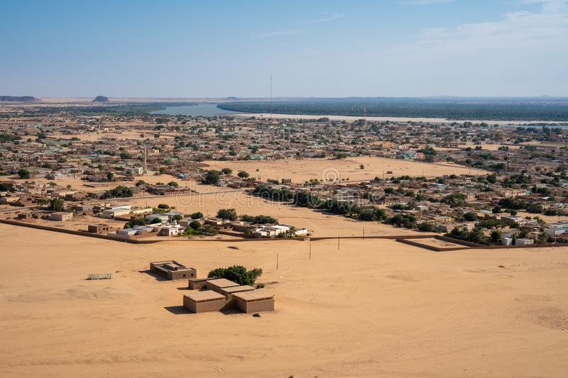 Sudanese town of Karima seen from Jebel Berkal. From Jebel Berkal you don`t only have a great view on the nearby pyramids but also the town of Karima stock photography