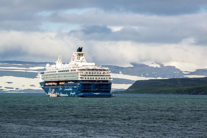 The Mein Schiff 2 cruise ship near Iceland. SUDAVIK, ICELAND - July 7, 2014: The Mein Schiff 2 cruise ship of TUI Cruises in the waters near the city of Sudavik stock image