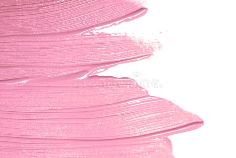 Sudda målarfärg eller kräm som isoleras på vit bakgrund arkivfoton