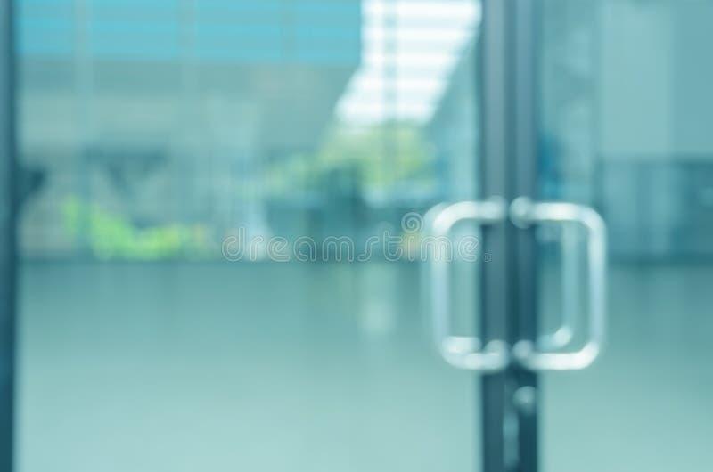 Suddig abstrakt glass dörr arkivbild