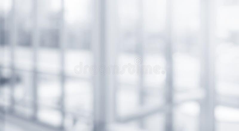 Suddig abstrakt grå glasväggbyggnadsbakgrund fotografering för bildbyråer