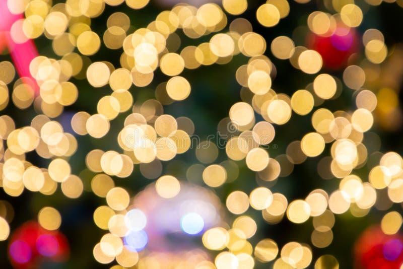 Suddig bokehljusbakgrund, jul och det nya året semestrar bakgrund arkivbild