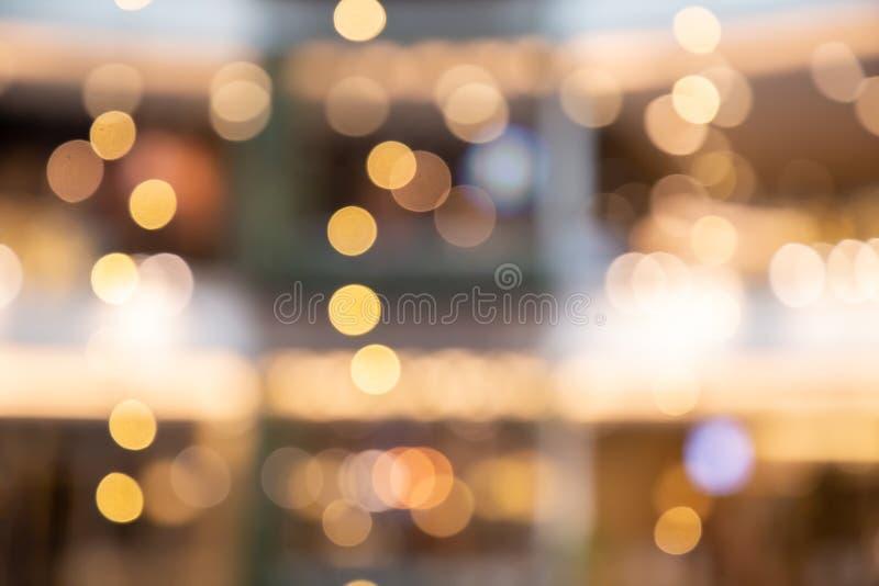 Suddig bokehljusbakgrund, jul och det nya året semestrar bakgrund Färgrik härlig suddig bokehbakgrund med kopian royaltyfria foton