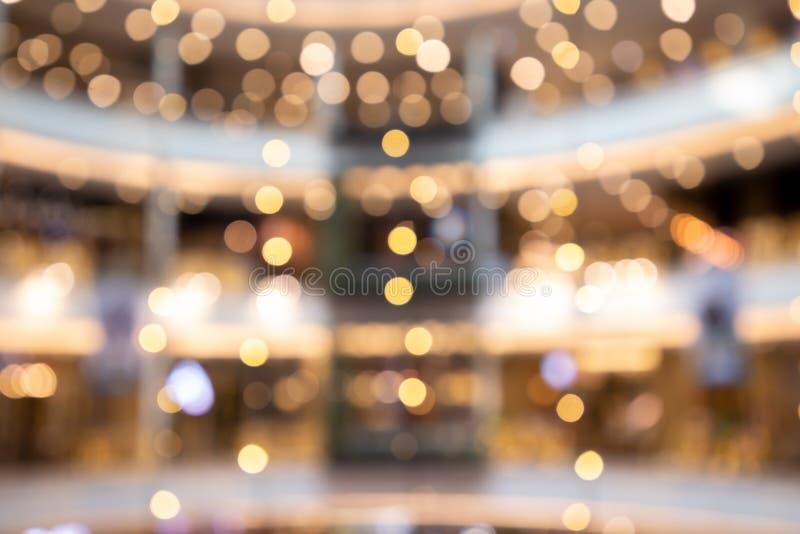 Suddig bokehljusbakgrund, jul och det nya året semestrar bakgrund Färgrik härlig suddig bokehbakgrund med kopian fotografering för bildbyråer