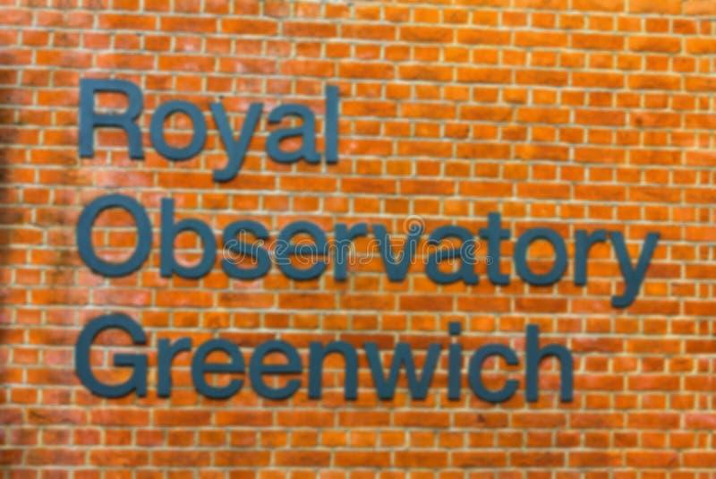 Suddig sikt av det kungliga observatoriumtecknet, London England royaltyfri fotografi