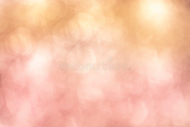 Suddiga bokehrosa färger för tappning och orange vårpastellbakgrund fotografering för bildbyråer