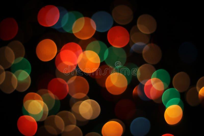 suddighet bokeh blossar linslampor arkivfoto