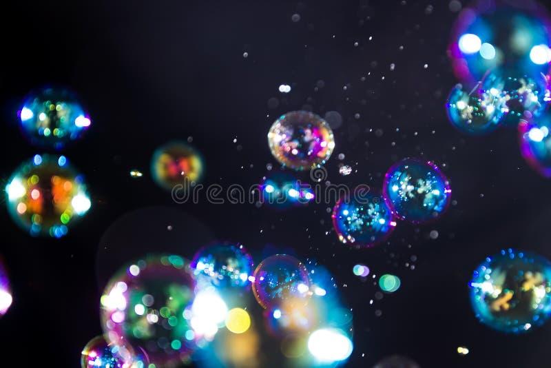Suddighetsbokehsåpbubblor arkivfoton