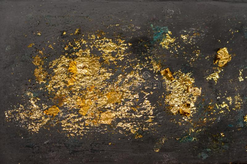 Suddighetstextur av bladguldet, guld- bakgrund, bild från Buddhabild tillbaka, bladguldbakgrund arkivbild
