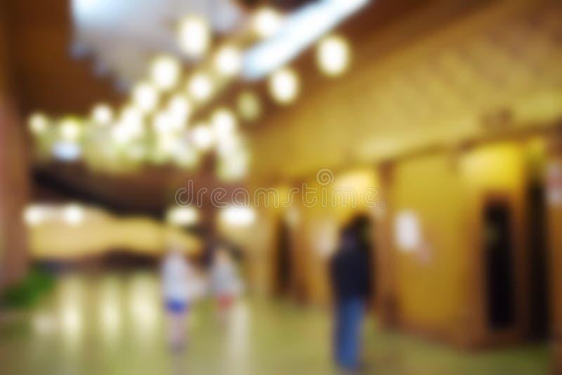 Suddigt foto av inre hotelllobbybakgrund fotografering för bildbyråer
