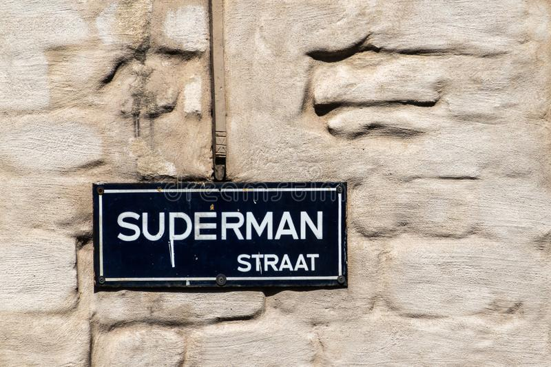 Suderman Straat becomes Superman Straat, Antwerpen, Belgium. Antwerpen, Belgium - June 23, 2019: Closeup of white on blue street name sign of Suderman Straat stock photos