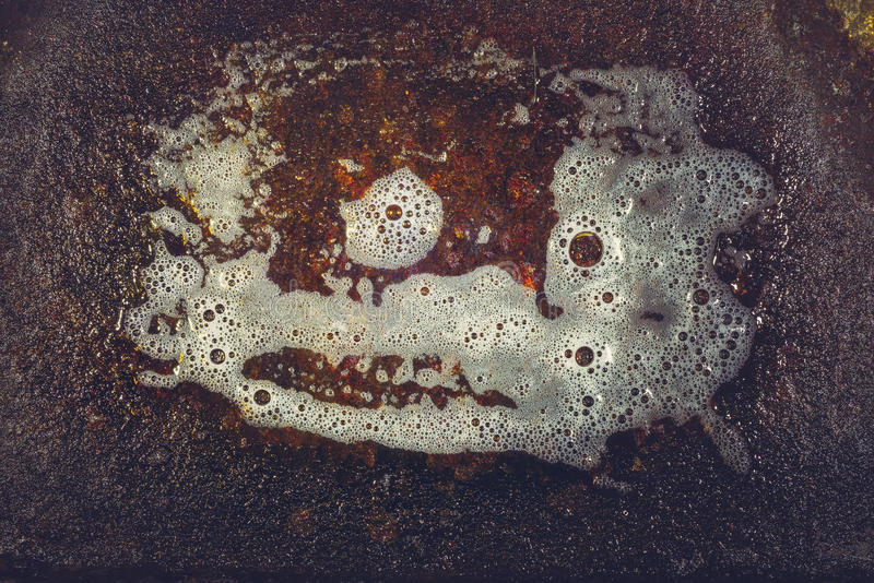 Suds and rust metal. Plate texture. Cleaning the surface of dirt stock images