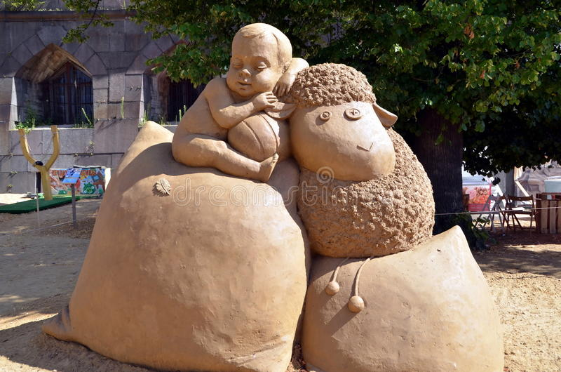 Sueño del niño Escultura de la arena foto de archivo