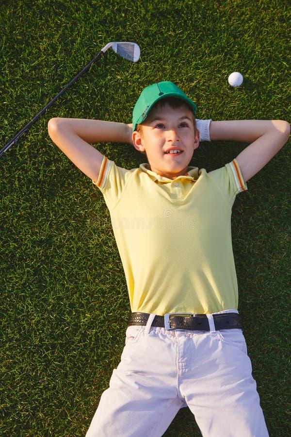 Sueños del golfista del muchacho fotos de archivo