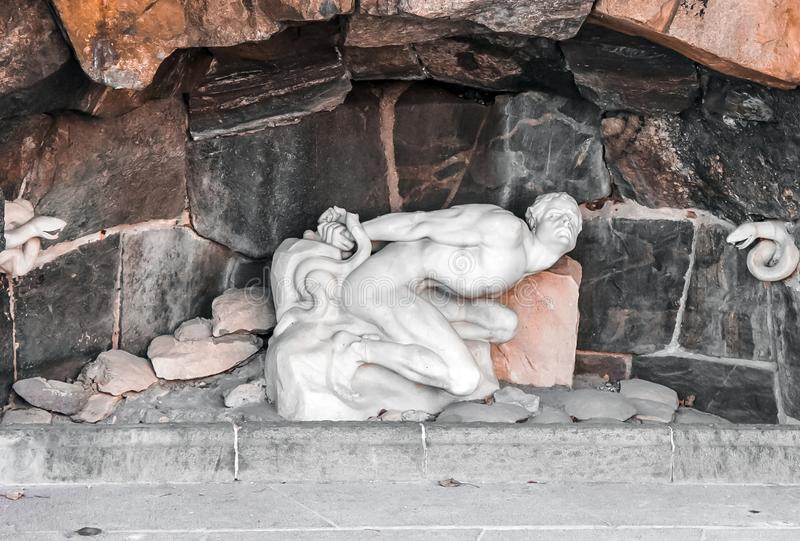 SUECIA, ESTOCOLMO - estatua de Loki With Snakes imagen de archivo libre de regalías