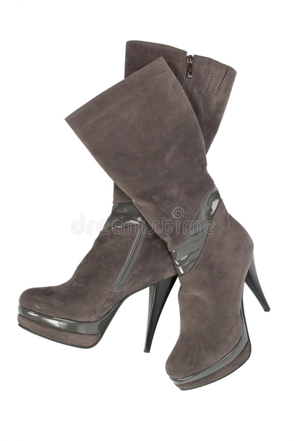 Suede boots on the platform and high heels stock image