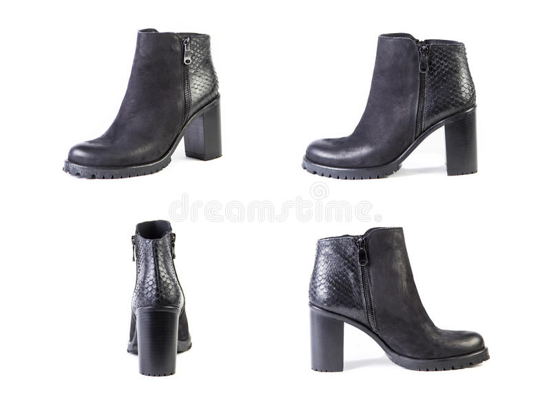 Suede women's boots on a white background, black shoes, autumn a stock photo