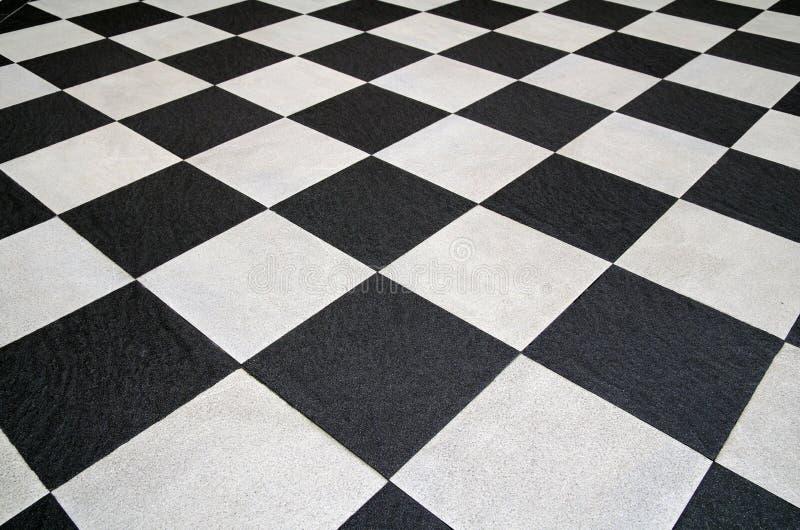 Suelo de azulejos blanco y negro cuadrado imágenes de archivo libres de regalías