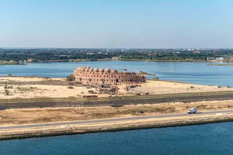 Suez Canal near Serapeum, Al Qantarah Sharq, Egypt. Serapeum, Egypt - November 5, 2017: Unfinished hotel on the Suez Canal near Serapeum, Al Qantarah Sharq stock photo