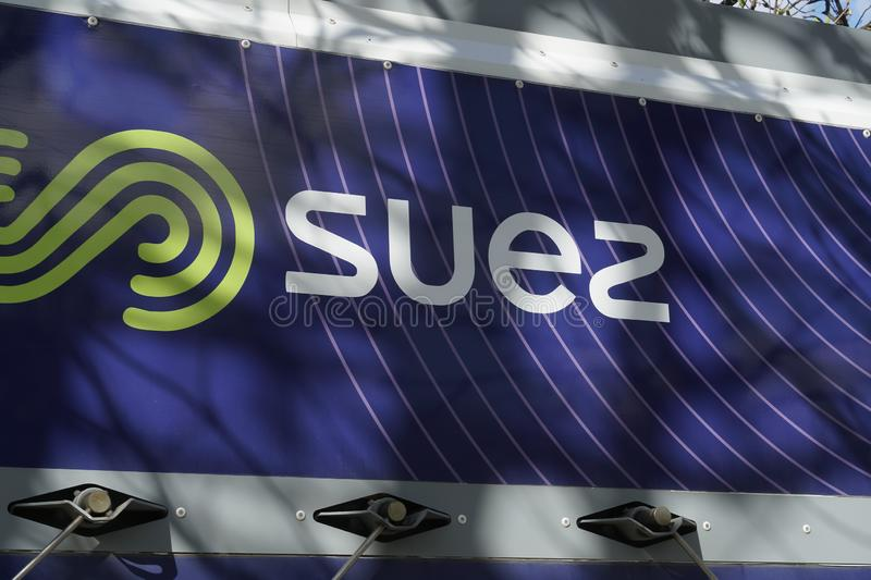 Suez Environnement company sign. Paris, France - March 19, 2019: SUEZ emblem. Suez Environnement SA is a French-based utility company which operates largely in stock photo