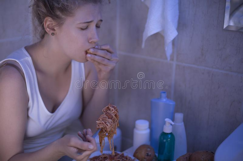 Suffering from bulimia. Young woman is suffering from bulimia nervosa royalty free stock image