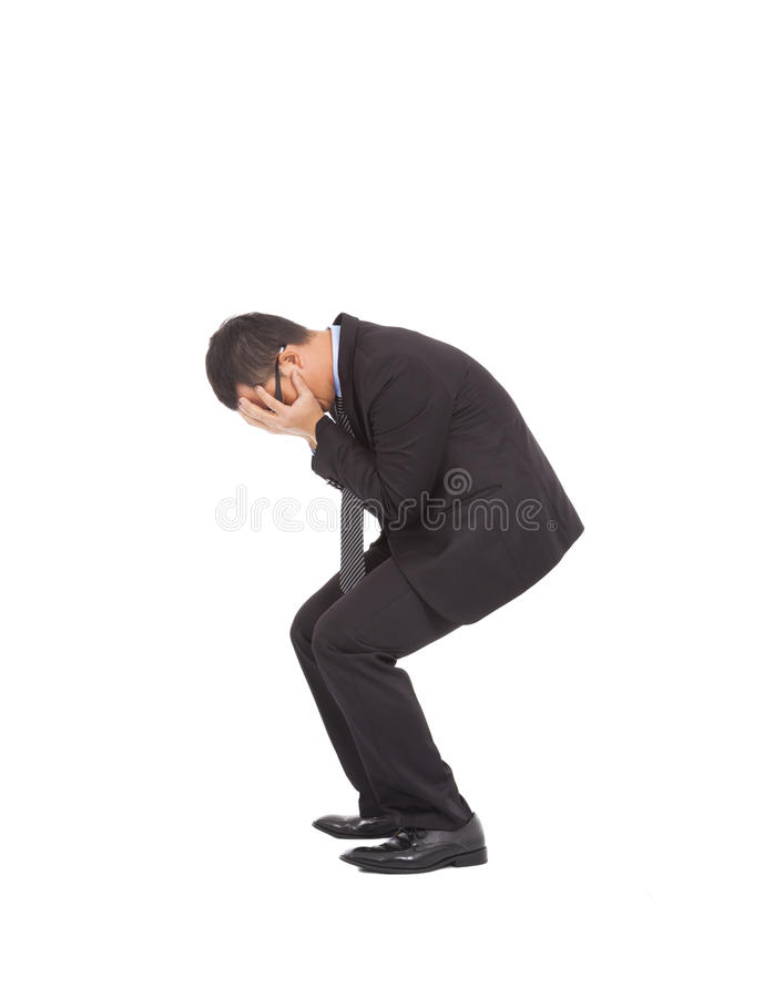 Suffering businessman squat to feel disappointment royalty free stock photography