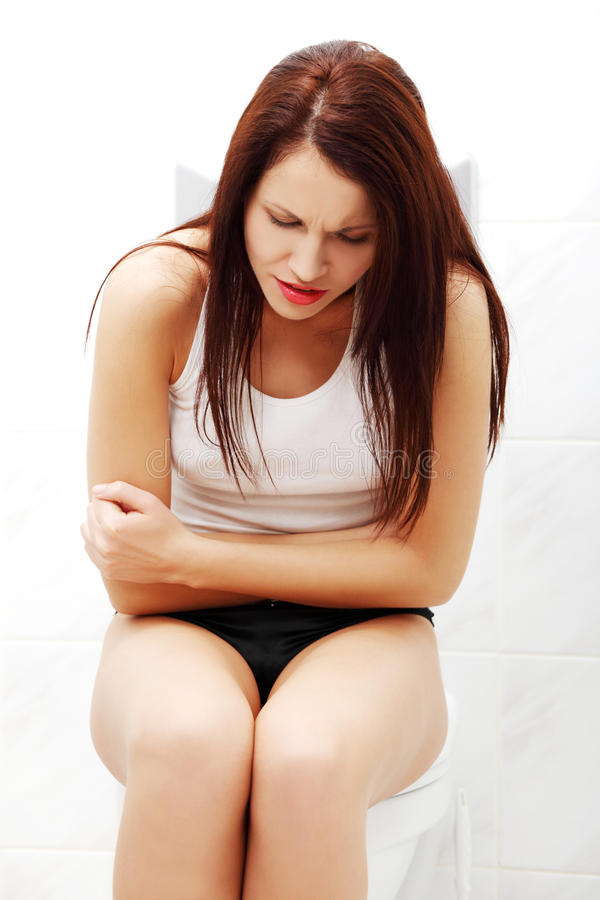 Suffering woman because of stomach ache. stock image