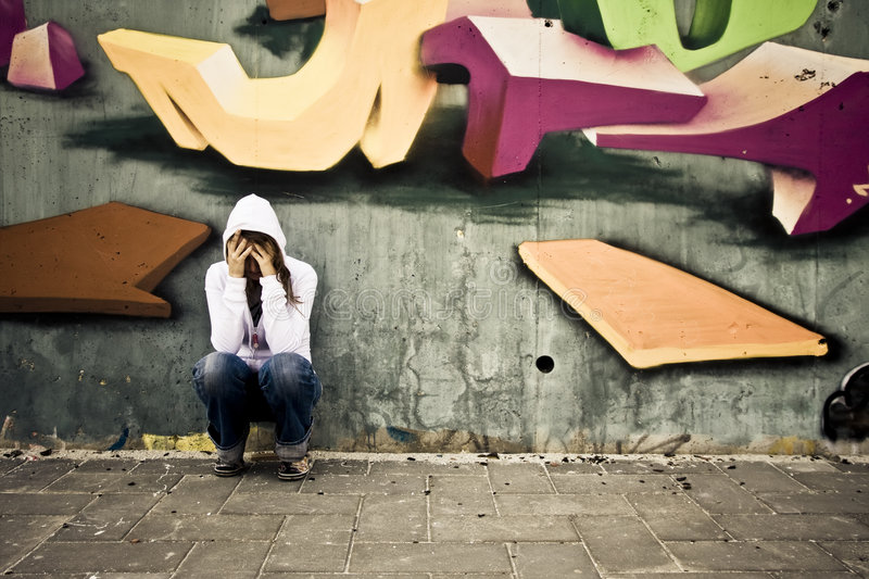 Suffering Woman On Wall Stock Image
