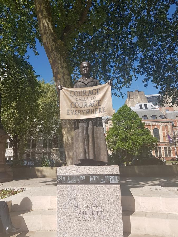 Suffragist sculpture in London. 90 years after her death, Millicent Fawcett becomes the first woman to be commemorated with a statue in Parliament Square with stock photo