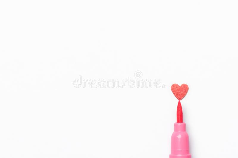 Sugar candy sprinkle in heart shape pink brush pen on white paper background. Imitation of drawing. Valentine. Mother`s Day Kids Charity Romantic Love Concept stock photography