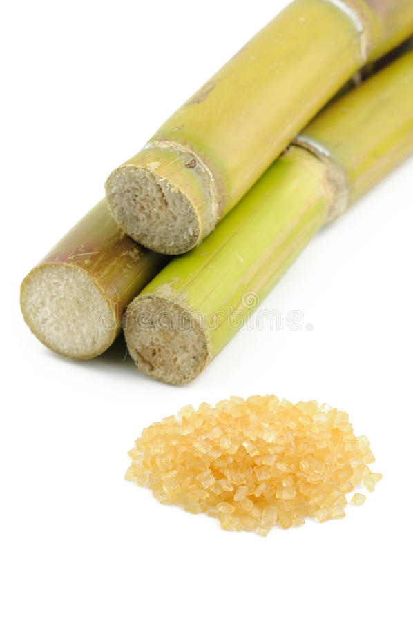 Sugar cane and brown sugar royalty free stock photos