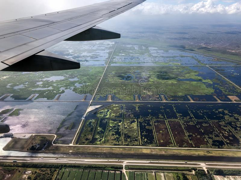 Sugar cane and swamps. Aerial view of swamps and sugar cane farms in South Florida royalty free stock photos