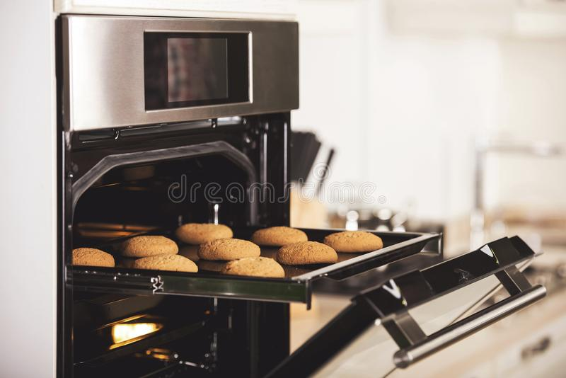 Sugar cookies baking in oven. royalty free stock photography