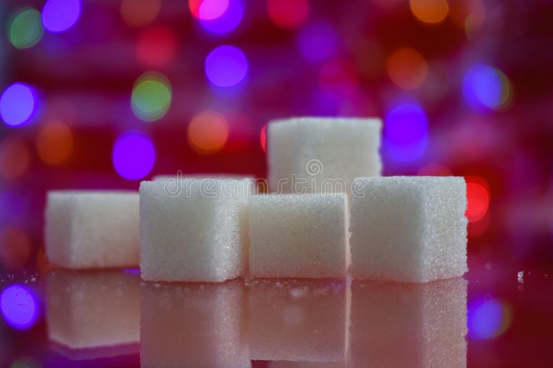 Sugar cube sweet white crystal macro beauty. Sugar cube cubes group granulated square eating sweet isolated colorful crystal macro object blue closeup tea bright royalty free stock photography