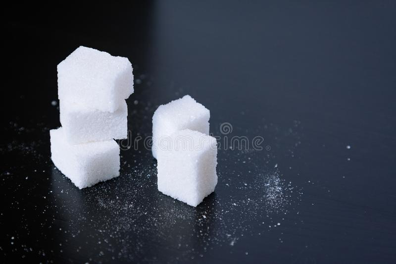 Sugar.Cubes on black. Sugar. Cubes on black background stock image