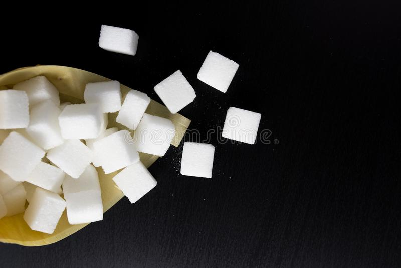 sugar cubes on black background royalty free stock images
