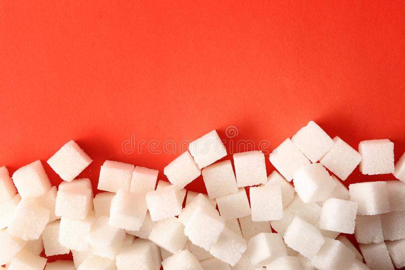 Sugar cubes on color background. Diabetes concept stock images