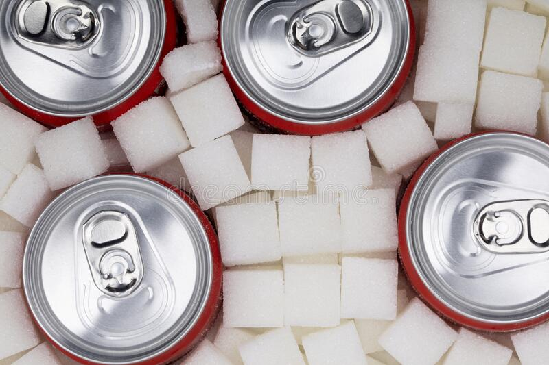 Sugar Cubes with soda can stock photography