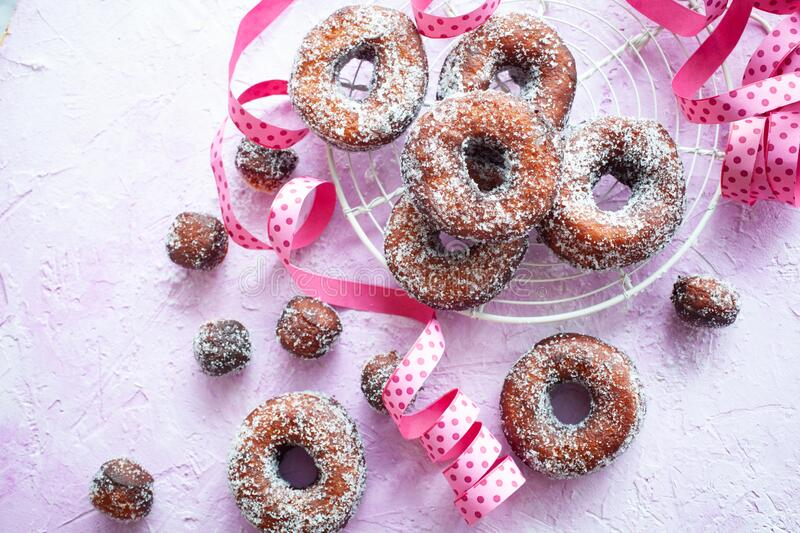 Sugar donuts on pink background royalty free stock photos