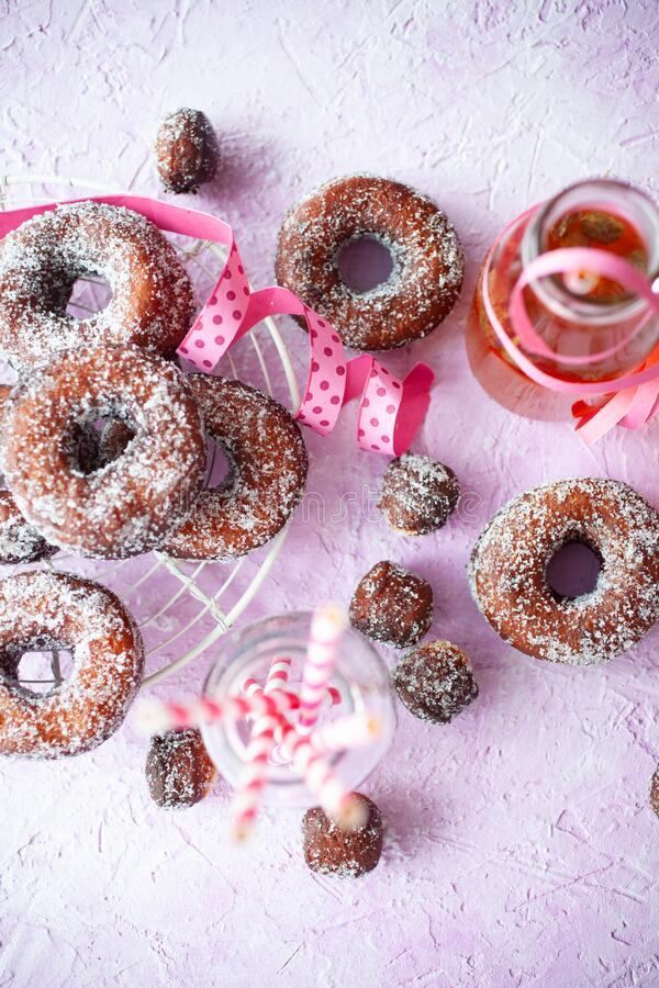 Sugar donuts on pink background stock photography